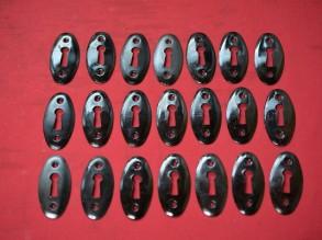 Zwarte ovale stalen sleutelrozetten